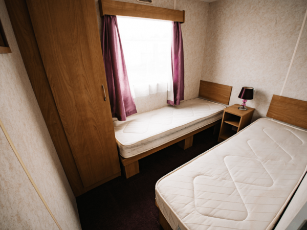 2011 Delta Santana 28ft x 12ft - 2 bed for sale at Castle Cove Caravan Park in Abergele North Wales - Twin Bedroom