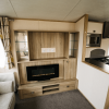 2017 Carnaby Oakdale 35ft x 12ft - 2 bed for sale at Castle Cove Caravan Park in Abergele North Wales - Fireplace and TV unit